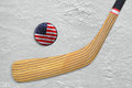Hockey stick and puck on an American hockey rink Royalty Free Stock Photo