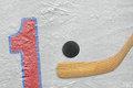 Hockey stick puck and the numeral one painted on ice Stock Image