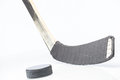 Hockey stick and puck on white background Royalty Free Stock Photos