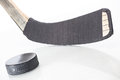 Hockey stick and puck on white background Royalty Free Stock Photography