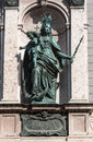 Hofgarten munich germany detail of the facade of a historical building a copper statue of a woman with a sword a crown and a cross Royalty Free Stock Photography