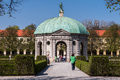 Hofgarten munich germany the facade of a historical building with green copper roof and a statue in bavaria Stock Image