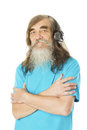 Hogere mens die aan muziek in hoofdtelefoons luisteren oude mens met baard Stock Afbeelding