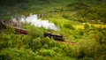 Hogwarts Express steam train from Harry Potter at Glenfinnan Scotland Royalty Free Stock Photo