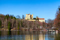 Hohenschwangau castle alpsee lake landscape view in spring red maple fall foliage bavaria germany Stock Photos