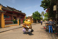 Hoi An, Vietnam - 13 April 2013: A garbage collector and her bicycle, Hoi An Ancient Town