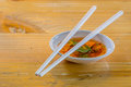 Hoisin & Chopsticks - Chopsticks resting on a small white bowl o Stock Photos