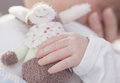 Hold cuddly toy a new born baby is holding a in his little hands Royalty Free Stock Image