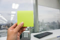 Hold a mockup green postit Royalty Free Stock Photo