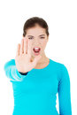 Hold on stop gesture showed by young woman hand Royalty Free Stock Photo