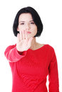 Hold on stop gesture showed by young woman hand Royalty Free Stock Images