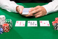 Holdem dealer with playing cards and casino chips gambling poker people entertainment concept close up of on green table Stock Images