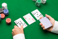 Holdem dealer with playing cards and casino chips gambling poker people entertainment concept close up of on green table Stock Photography
