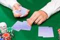 Holdem dealer with playing cards and casino chips gambling poker people entertainment concept close up of on green table Stock Photos
