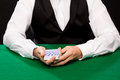 Holdem dealer with playing cards casino gambling poker people and entertainment concept close up of Royalty Free Stock Images