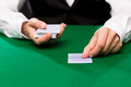 Holdem dealer with playing cards casino gambling poker people and entertainment concept close up of Stock Photo