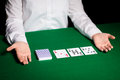 Holdem dealer with playing cards casino gambling poker people and entertainment concept close up of Stock Photos