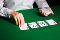 Holdem dealer with playing cards casino gambling poker people and entertainment concept close up of Royalty Free Stock Image