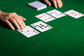 Holdem dealer with playing cards casino gambling poker people and entertainment concept close up of hands Stock Images
