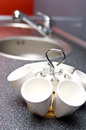 A holder with white cups on a kitchen desk Stock Photo