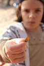 Holding an autumn leaf a small girl a small Royalty Free Stock Photography