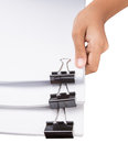 Holding Binder Clips And White Paper III Royalty Free Stock Photo