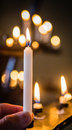 Holding a candle Royalty Free Stock Photo