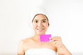 Holding card asian woman in spa Royalty Free Stock Photo