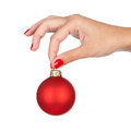 Holding christmas ball woman red close up of hand isolated on white Stock Photos