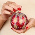 Holding christmas ball woman red close up of hands on white t shirt background Stock Photography