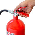 Holding fire extinguisher Royalty Free Stock Photo