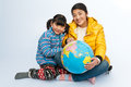 Holding a globe happy mother and daughter Royalty Free Stock Photos