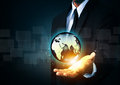 Holding a glowing earth globe in hand Royalty Free Stock Photo