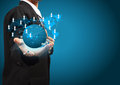 Holding a glowing earth globe social network in the hands of businessmen Stock Photos