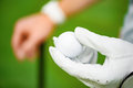 Holding golf ball on hand Royalty Free Stock Photo
