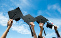 Holding graduation hats many hand on background of blue sky Royalty Free Stock Photo