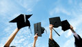 Holding graduation hats many hand on background of blue sky Stock Photography