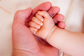 Holding a hand of the newborn child father Royalty Free Stock Photos