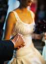 Holding hands bride and groom in church at their wedding ceremony Royalty Free Stock Image