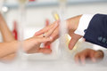 Holding hands in cafe bride and groom crossed their fingers Royalty Free Stock Photo