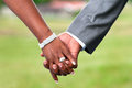 Holding hands cropped view of an african couple s at their wedding wide aperture used Royalty Free Stock Photo