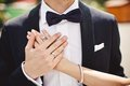 Holding hands with wedding rings Royalty Free Stock Photo