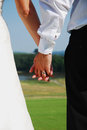 Holding hands wedding rings together Royalty Free Stock Photography
