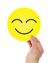 Holding happy smiley face a isolated on white background have a nice day Stock Photos