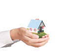 Holding house representing home ownership and the real estate business Stock Image