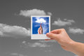 Holding instant photo cloud computing concepts on a black sky background Stock Photo