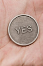 Holding the odds flipped coin on a hand background Royalty Free Stock Photography