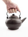 Holding old teapot Royalty Free Stock Photography