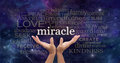 Holding out for a miracle word cloud female hands stretched up and reaching to the surrounded by relevant on dark deep space Royalty Free Stock Photography