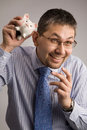 Holding a piggy bank Stock Photography